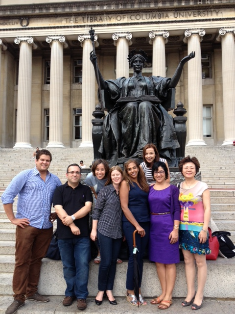 1.Catherine (back right) and some of her Columbia classmates pose at the Alma Mater statue on the university's campus.