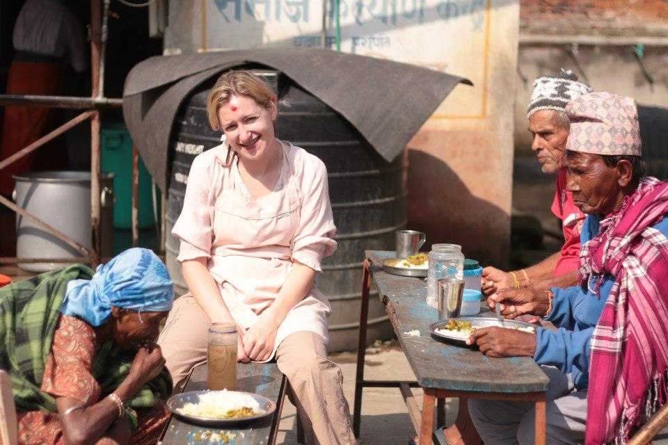 Account Director Martina Quinn volunteering at a nursing home in Kathmandu, Nepal, as part of DHR Communications' corporate social responsibility activities