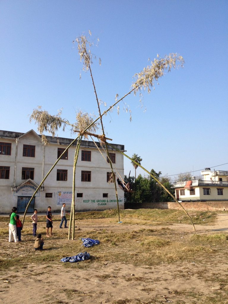 Shree Baal Byabashyee school building.  The giant bamboo swing in the foreground was erected in front of the school as part of the traditional celebrations to mark the Dasain festival.  For the festival, huge swings like this are erected temporarily in villages and cities all over Nepal.